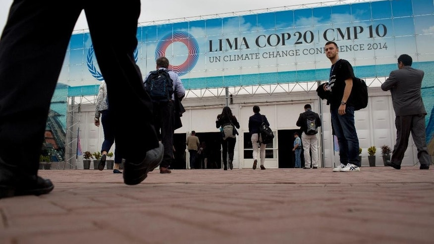 People arrive to the Climate Change Conference in Lima, Peru, Monday, Dec. 1, 2014. Delegates from more than 190 countries will meet in Lima for two weeks to work on drafts for a global climate deal that is supposed to be adopted next year in Paris. (AP Photo/Rodrigo Abd)