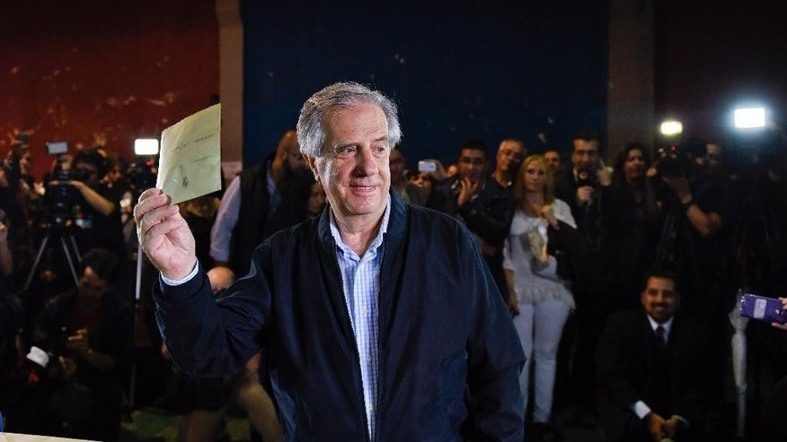 Tabare Vazquez, presidential candidate for the ruling Broad Front party, casts his vote in the presidential runoff election Sunday, Nov. 30, 2014, in Montevideo, Uruguay. Vazquez is favored to win the presidential runoff election Sunday on the back of a strong economy. (AP Photo/Matilde Campodonico)