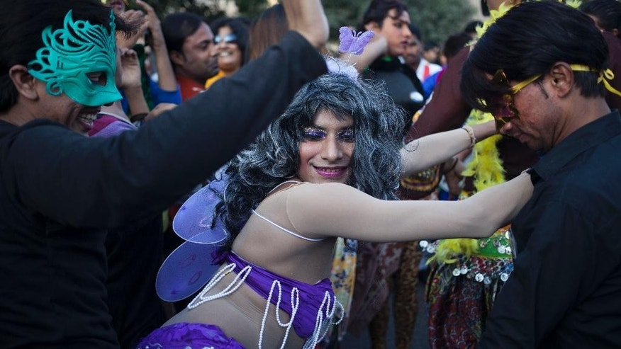 Participants dance during a gay rights parade in New Delhi, India, Sunday, Nov. 30, 2014. Nearly a thousand gay rights activists marched Sunday to demand an end to discrimination against gays in India's deeply conservative society.(AP Photo/Tsering Topgyal)
