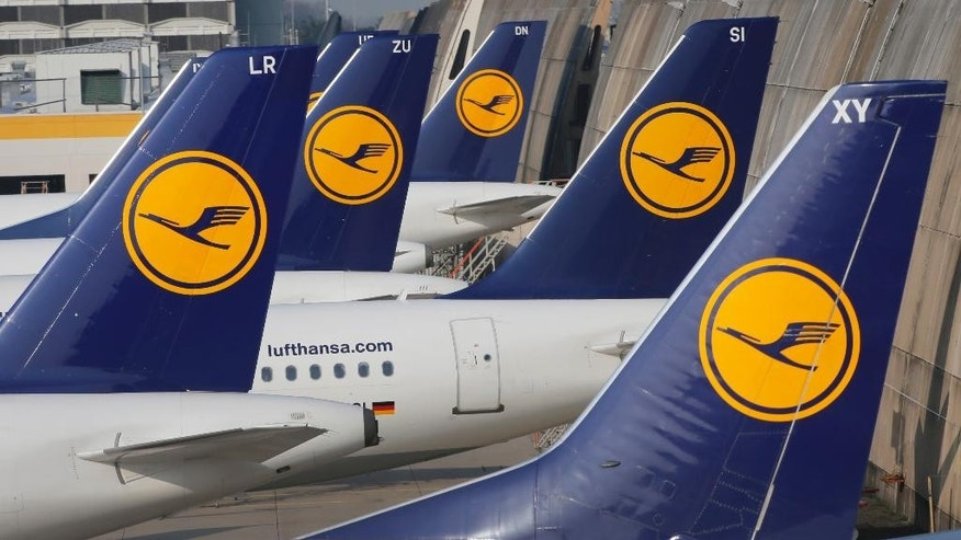 FILE - In this April 2, 2014 file picture Lufthansa aircrafts are parked as Lufthansa pilots went on a three-days-strike in Frankfurt, Germany. A union representing Lufthansa pilots has called on its members to go on strike starting Monday, in a dispute over retirement benefits. The Vereinigung Cockpit union said Sunday Nov. 30, 2014  that the strike will begin on short- and medium-haul services at noon (1100 GMT) Monday, and be extended to long-haul and cargo flights from 3 a.m. (0200 GMT) Tuesday. The walk-out is due to end Wednesday.  (AP Photo/Michael Probst,file)