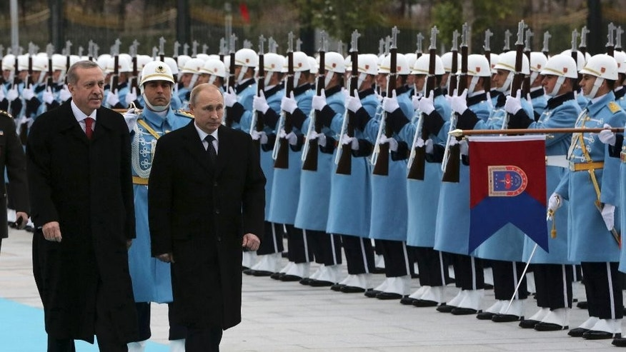 Dec. 1, 2014 - Russian President Vladimir Putin and Turkish counterpart  Recep Tayyip Erdogan inspect military honor guard at a welcome ceremony at the presidential Palace in Ankara. Putin will meet with Erdogan amid striking differences over the crises in Syria and Ukraine, but the 2 presidents were expected to focus on booming economic and trade ties.