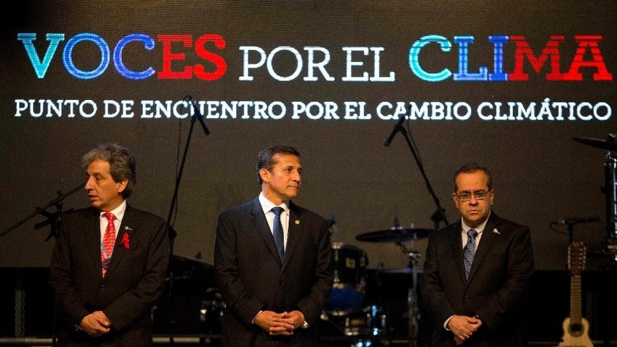 Peruvian Minister of the Environment and COP20 President Manuel Pulgar, left, Peruvian President Ollanta Humala, center, and  and Education Minister Jaime Saavedra attend a conference during the Climate Change Conference in Lima, Peru, Monday, Dec. 1, 2014. Delegates from more than 190 countries will meet in Lima for two weeks to work on drafts for a global climate deal that is supposed to be adopted next year in Paris. (AP Photo/Rodrigo Abd)