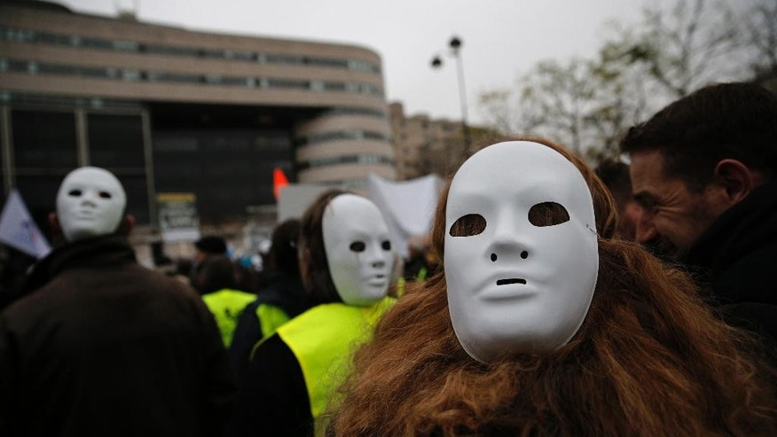 Small and medium-sized enterprise owners demonstrate in Paris, France, Monday, Dec. 1, 2014. Several thousand French business owners, particularly from small companies, demonstrated to plead with the government to simplify regulations and make it easier and cheaper to hire. (AP Photo/Christophe Ena)