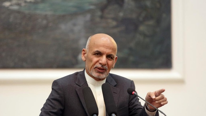 In this Thursday, Nov. 6, 2014 photo, Afghanistan's President Ashraf Ghani speaks during a press conference at the presidential palace in Kabul, Afghanistan. Facing an intensified Taliban insurgency, Ghani plans to fire senior civilian and military leaders in the country's most volatile provinces to reinvigorate the battle against militants, officials have told The Associated Press. Afghanistan faces a looming challenge as U.S. forces will be reduced to 9,800 by the end of this year, before a planned complete withdrawal at the end of 2016.(AP Photo/Massoud Hossaini)