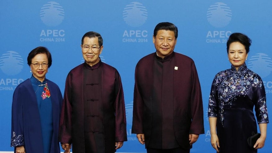 In this Nov. 10, 2014 file photo, Vincent Siew, second left, chairman of the Taiwan-based Cross-Strait Common Market Foundation, and his wife Chu Su-hsien, left, are greeted by Chinese President Xi Jinping, second right, and his wife Peng Liyuan before a welcome dinner for APEC leaders at the Beijing National Aquatics Center in Beijing. An electoral pummeling for Taiwan's pro-Beijing ruling party and a new spike in pro-democracy protests in Hong Kong have delivered a reality check to Xi just when he was riding a wave of high-profile diplomacy. (AP Photo/Ng Han Guan, File)