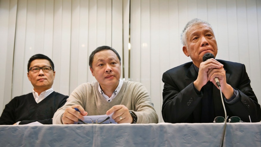 Dec. 2, 2014: Three protest leaders, from left, Chan Kin-man, Benny Tai Yiu-ting and Chu Yiu-ming, attend a news conference in Hong Kong
