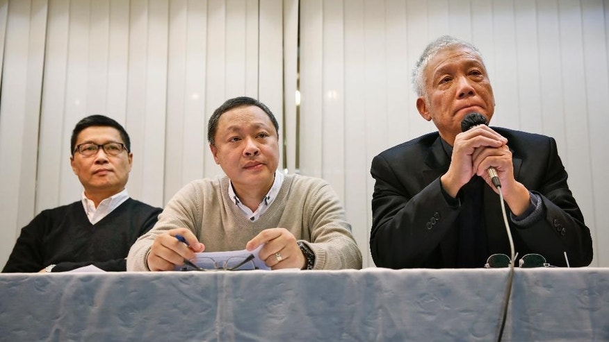 Three protest leaders, from left, Chan Kin-man, Benny Tai Yiu-ting and Chu Yiu-ming, attend a news conference in Hong Kong Tuesday, Dec. 2, 2014 as they announce that they will surrender to police. Three protest leaders in Hong Kong - two professors and a pastor - are calling for an end to street demonstrations to prevent violence and take the campaign for democratic reforms to a new stage. (AP Photo/Kin Cheung)
