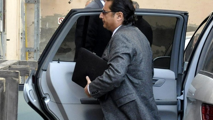 Francesco Schettino arrives to offer his first court testimony about the 2012 shipwreck off an Italian island that killed 32 people, in Grosseto, Italy, Tuesday, Dec. 2, 2014. The captain of the Costa Concordia cruise ship offered his first court testimony Tuesday about the 2012 shipwreck off an Italian island that killed 32 people, sitting hunched behind a table on a theater's stage while prosecutors questioned him from the first row. While Francesco Schettino has long said he looked forward to his day in court to vindicate himself, he was granted a request not to have his image, and only his voice, broadcast from the theater that has served as a courtroom due to the widespread interest in the case. Schettino is being tried alone on charges of manslaughter, causing a shipwreck. (AP Photo/Giacomo Aprili)