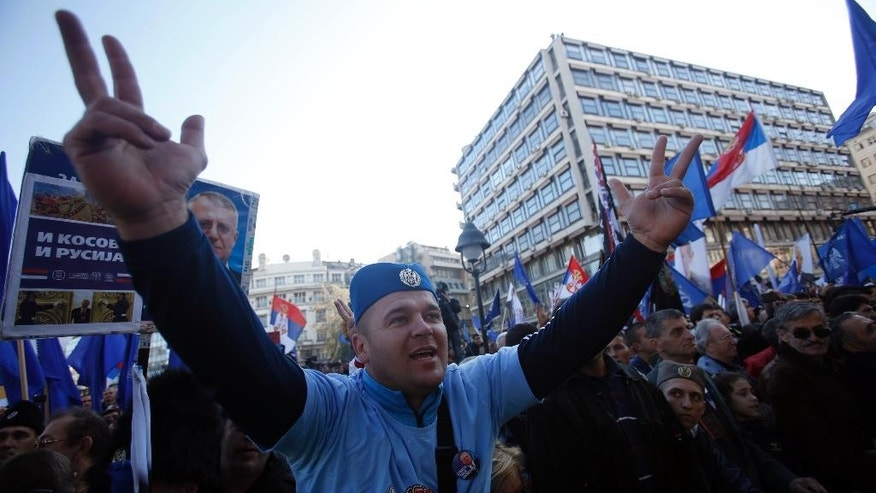 In this photo taken Saturday, Nov. 15, 2014, a supporter of Serbian ultranationalist leader Vojislav Seselj shouts slogans during the rally in Belgrade, Serbia. Putin and Russia ties also were strongly featured last week at an ultranationalist rally in Belgrade when 10,000 people cheered Vojislav Seselj, Serbian Prime Minister Aleksandar Vucic's former party boss now on provisional release from the U.N. war crimes tribunal. Evoking hate speech that marked Milosevic's era, Seselj said Serbia should scrap EU integration and turn entirely toward Russia. (AP Photo/Darko Vojinovic)