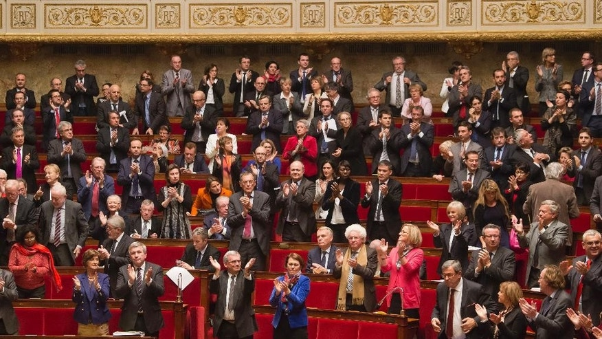 Members of French parliament, applaude after the vote for the recognition of the Palestinian State in Paris, Tuesday, Dec. 2, 2014. France's lower house of Parliament has voted to urge the government to recognize a Palestinian state, in the hope that speeds up peace efforts after decades of conflict. Tuesday's French vote, approved with 339 votes to 151, is non-binding. (AP Photo/Michel Euler)