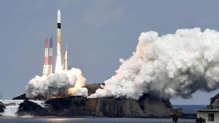 An H2-A rocket carrying space explorer Hayabusa2, lifts off from a launching pad at Tanegashima Space Center in Kagoshima, southern Japan, Wednesday, Dec. 3, 2014.  The Japanese space explorer was launched Wednesday on a six-year roundtrip journey to blow a crater in a remote asteroid and collect samples from inside in hopes of gathering clues to the origin of earth. (AP Photo/Kyodo News) JAPAN OUT, MANDATORY CREDIT