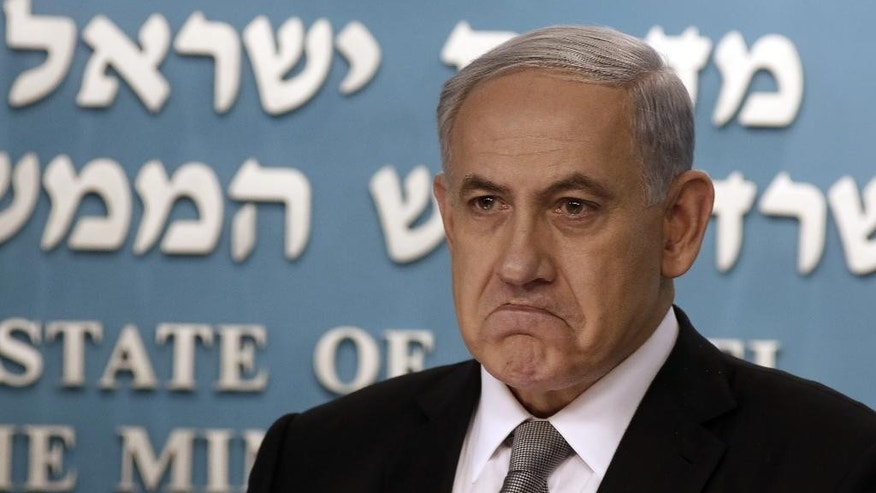 Israeli Prime Minister Benjamin Netanyahu gestures during a press conference in Jerusalem, Tuesday Dec. 2, 2014. Israel's prime minister fired two senior Cabinet ministers from his divided government Tuesday and said he would call early elections, plunging the country toward a heated campaign more than two years ahead of schedule. (AP Photo/Gali Tibbon, Pool)