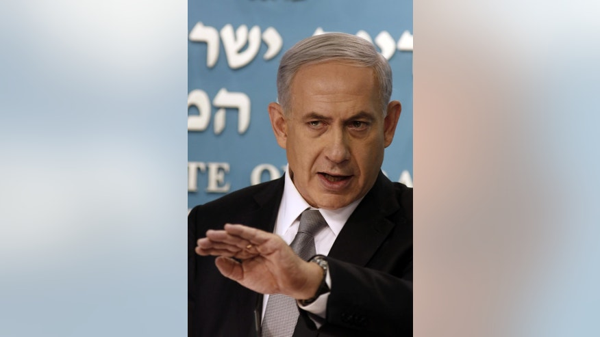 Israeli Prime Minister Benjamin Netanyahu speaks during a press conference in Jerusalem, Tuesday Dec. 2, 2014. Israel's prime minister fired two senior Cabinet ministers from his divided government Tuesday and said he would call early elections, plunging the country toward a heated campaign more than two years ahead of schedule. (AP Photo/Gali Tibbon, Pool)