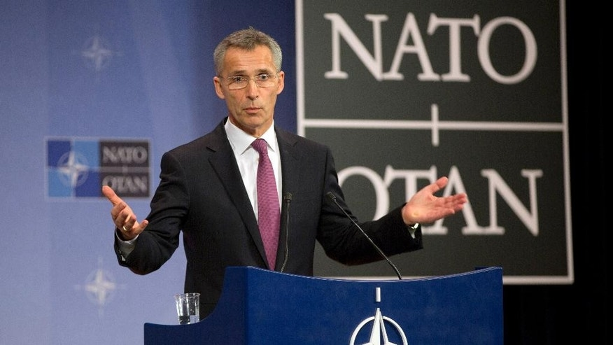 NATO Secretary General Jens Stoltenberg gestures while speaking during a media conference prior to a meeting of the North Atlantic Council at NATO headquarters in Brussels on Tuesday, Dec. 2, 2014. NATO's chief says alliance foreign ministers are poised to make a number of key decisions, including the shift to a non-combat role for NATO-led forces in Afghanistan beginning Jan. 1. Alliance foreign ministers, including Secretary of State John Kerry, are scheduled to assemble at NATO headquarters later in the day. (AP Photo/Virginia Mayo)