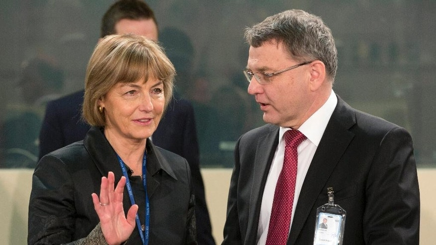 Croatian Foreign Minister Vesna Pusic, left, speaks with Czech Republic's Foreign Minister Lubomir Zaoralek, right, during a round table meeting of the NATO-Ukraine Commission at NATO headquarters in Brussels on Tuesday, Dec. 2, 2014. NATO's chief says alliance foreign ministers are poised to make a number of key decisions, including the shift to a non-combat role for NATO-led forces in Afghanistan beginning Jan. 1. Alliance foreign ministers, including Secretary of State John Kerry, are scheduled to assemble at NATO headquarters later in the day. (AP Photo/Virginia Mayo)