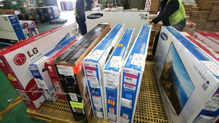 In this Dec. 1, 2014 photo, Samsung and LG Electronic TVs directly purchased from overseas online markets undergo customs inspections at Incheon International Airport Customs in Incheon, South Korea. The volume of goods ordered by Korean shoppers from websites overseas has surged in recent years and sales are forecast to set a record high this year above $1 billion. It remains small compared with retail sales within South Korea, which are forecast at $243 billion this year, but is expanding at a faster rate.  (AP Photo/Yonhap, Park Ji-ho) KOREA OUT