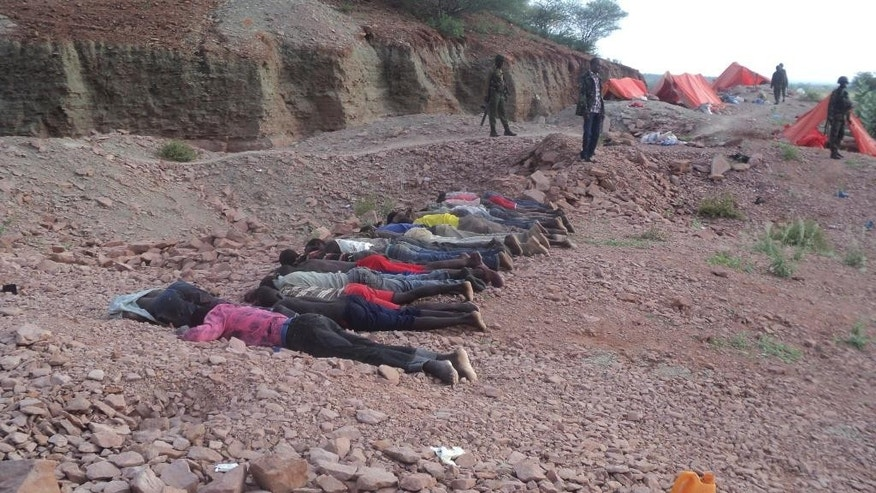 Dec. 2, 2014: Bodies of Kenyans lie at a quarry in Mandera County, Kenya. Kenya police said that at least 36 quarry workers were killed in an attack in northern Kenya  by suspected Islamic extremists from Somalia. Kenyan police chief David Kimaiyo confirmed the workers were killed early Tuesday in Mandera County.