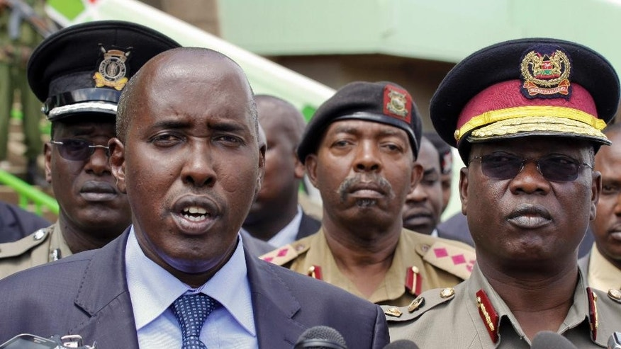 FILE - In this  Wednesday, April 9, 2014 photo, Kenya's Interior Minister Joseph Ole-Lenku, left, and Police Chief General David Kimaiyo, right, speak to the media at the Kasarani sports stadium, Nairobi, Kenya. Kenya's Interior Minister Joseph Ole-Lenku has been fired and the police chief David Kimaiyo has resigned following an attack Tuesday Dec. 2, 2014 by Islamic extremists from Somalia that killed tens of people. (AP Photo/Khalil Senosi-File)
