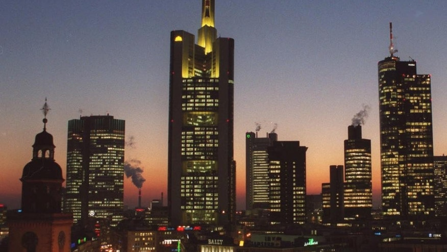 FILE- In this file photo dated Feb. 2000, showing the banking district in downtown Frankfurt, Germany, with buildings from left: Church St. Catherine, European Central Bank, Commerzbank Headquarters, Dresdner Bank, Japan Tower, Citibank, Main Tower.  On Tuesday Dec. 2, 2014, the issue of looming deflation seems the main factor driving European policymakers when they meet later this week and forcing speculation that the ECB will switch on the printing press to help the economy by injecting new money into the economy. (AP Photo/Bernd Kammerer, FILE)