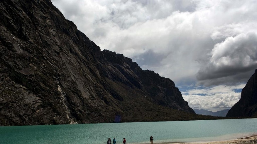 People gather near the Chinamacocha lake in the Huascaran National Park in Huaraz, Peru, Tuesday, Dec. 2, 2014. Glaciers have lost more one-fifth of their mass in just three decades, and the 70 percent Peru's 30 million people who inhabit the country's Pacific coastal desert, depend on glacial runoff for hydropower and to irrigate crops, meaning their electricity and long-term food security could also be in peril. Higher alpine temperatures are killing off plant and animal species in cloud forests and scientists predict Pacific fisheries will suffer. (AP Photo/Rodrigo Abd)