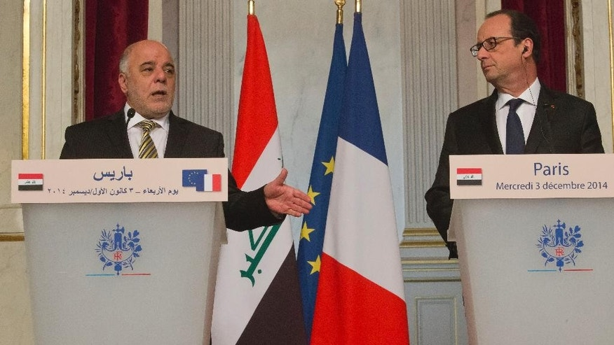 Iraqi Prime Minister Haider al-Abadi, left, and France's President Francois Hollande, right, attend a joint media conference at the Elysee Palace in Paris, Wednesday, Dec. 3, 2014. Iraqi Prime Minister Haider al-Abadi met earlier with U.S. Secretary of State John Kerry in Brussels to discuss the fight against Islamic State militants. (AP Photo/Michel Euler)