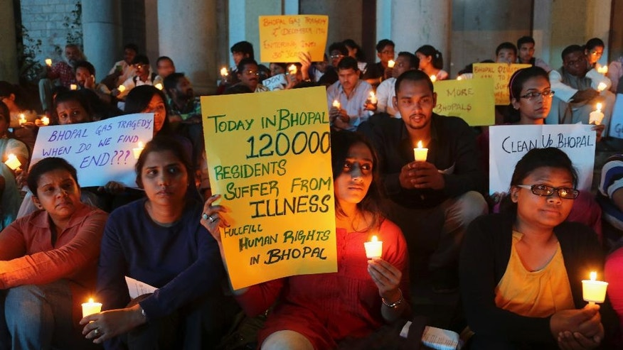 Members of student groups and activists of social organizations participate in a candle light vigil to express solidarity with the Bhopal gas tragedy survivors on the eve of its 30th anniversary in Bangalore, India, Tuesday, Dec. 2, 2014. Thousands of people died after a cloud of methyl isocyanate gas on On Dec. 3, 1984, escaped from a pesticide plant operated by a Union Carbide subsidiary in Bhopal in central India, affecting the lives of many. (AP Photo/Aijaz Rahi)