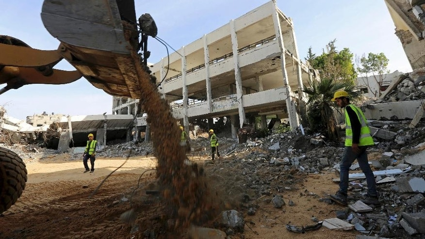 Dec. 3, 2014: Palestinian workers remove the rubble of Jamal Abdelnaser UNRWA School which was destroyed during the recent conflict between Israel and Hamas in Shijaiyah, neighborhood in Gaza City, in the northern Gaza Strip. (AP)