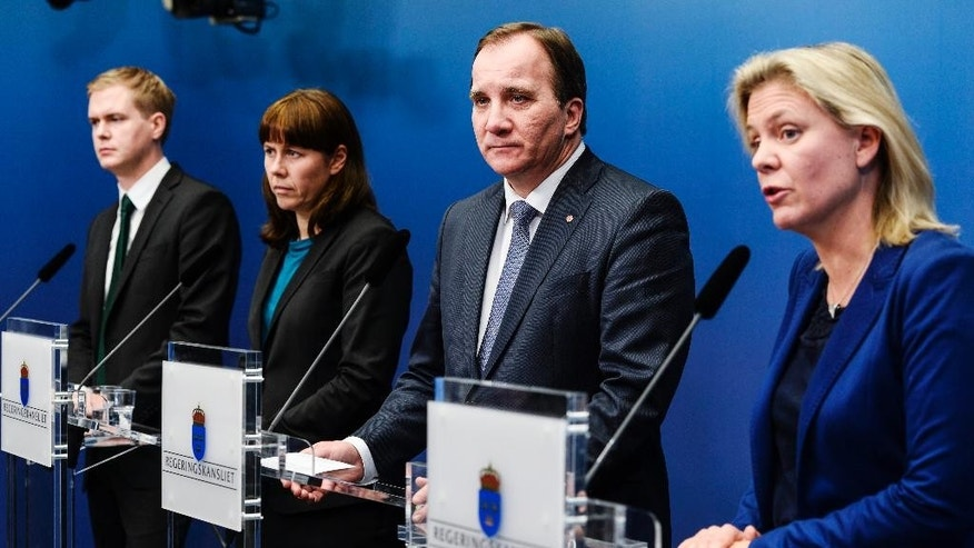 Sweden's Prime Minister Stefan Lofven, Social Democrats, second from right, talks at a press conference at the chancellery in Stockholm, Sweden, late Tuesday Dec. 2, 2014. He is surrounded by, from left, Minister of Education Gustav Fridolin and Deputy Prime Minister Asa Romson of the Green Party and Finance Minister Magdalena Andersson of the Social Democrats. Lofven said the government's talks with the center-right opposition had not resulted in their support for the government's national budget. (AP Photo/TT News Agency, Pontus Lundahl)    SWEDEN OUT
