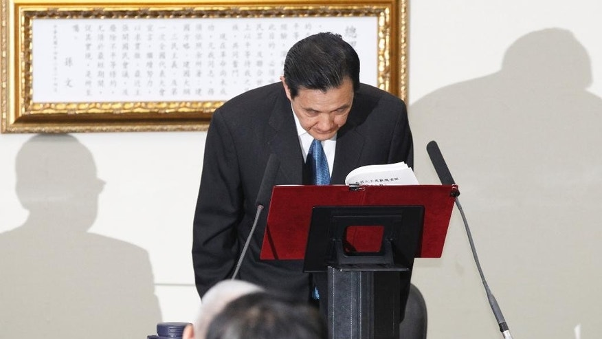 Taiwan's President Ma Ying-jeou bows as he tenders his resignation as chairman of the ruling Nationalist Party following its major defeat in island-wide local elections at the party headquarters in Taipei, Taiwan, Wednesday, Dec. 3, 2014. China called on Taiwan on Wednesday to stay the course of deepening exchanges between the sides after a stunning electoral defeat for the island's ruling pro-China Nationalist Party. (AP Photo/Wally Santana)