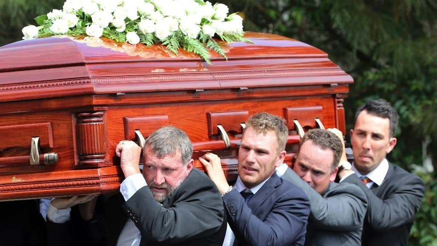 Pall bearers from left,  Gregory Hughes, Aaron Finch, Corey Ireland and Tom Cooper carry the coffin of Australian cricketer Phillip Hughes to the hearse during his funeral in Macksville, Australia, Wednesday, Dec. 3, 2014. Hughes died last Thursday, aged 25, after being hit near the ear by a ball during a match at the Sydney Cricket Ground.  (AP Photo/Rob Griffith)