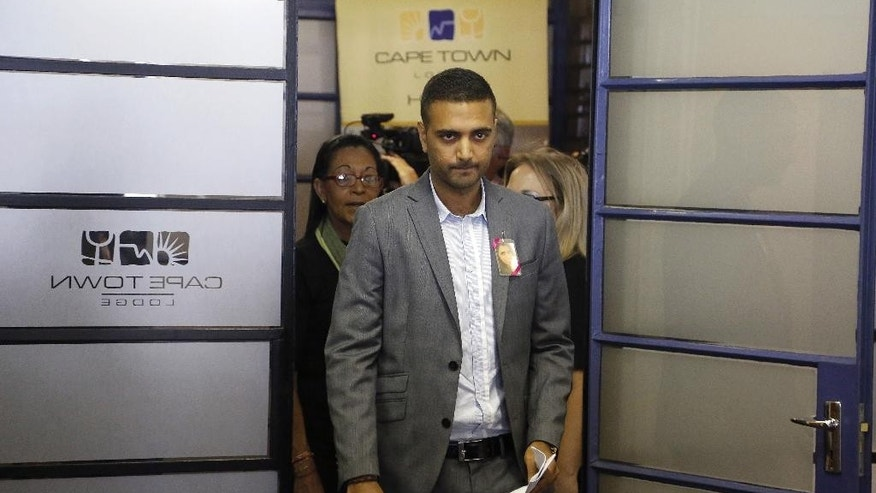 "Anish Hindocha, the brother of Anni Dewani who was murdered during her honeymoon in South Africa in 2010, arrives at a press conference with other family members in the city of  Cape Town, South Africa, Wednesday, Dec. 3, 2014. With his sister's photograph pinned to his jacket, Anish Hindocha on Wednesday asked his sister's husband to tell the ""full story"" of how she was murdered while on honeymoon in Cape Town. (AP Photo/Schalk van Zuydam)"