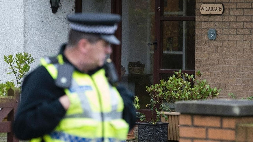 Police attend the scene at the vicarage in Freckleton, England, after reports emerged Thursday Dec. 4, 2014, that the vicar named locally as Rev Jim Percival was arrested earlier this week and that his wife and daughter are being questioned over the suspicious death of a baby boy.  Police were called to investigate a report that a woman had given birth to a stillborn baby, resulting in a vicar, his wife and his daughter being questioned in connection with suspicion of murder and conspiracy to conceal the birth of a child. (AP Photo / Joel Goodman, PA) UNITED KINGDOM OUT - NO SALES - NO ARCHIVES