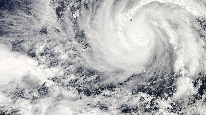 This image captured by NASA's Aqua satellite shows Typhoon Hagupit on Wednesday, Dec. 3, 2014 at 04:30 UTC in the western Pacific Ocean. The Philippines weather bureau is advising the public to brace for Typhoon Hagupit which continues to head towards the central Philippines and looking at the possibility it might hit the same areas as super Typhoon Haiyan which devastated Tacloban last year. (AP Photo/NASA Goddard MODIS Rapid Response)