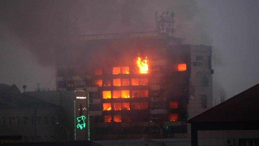 Dec. 4, 2014: A publishing house building is seen in flames in the center of Grozny, Russia