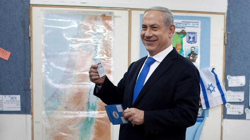 FILE - In this Jan. 22, 2013 file photo Israeli Prime Minister Benjamin Netanyahu casts his ballot at a polling station in Jerusalem. Polls this week suggest that the conservative Netanyahu, who has been prime minister for about a third of his nearly three decades in politics,  is likely to be returned for a fourth term when Israel will go to the polls on March 17, 2015. But new developments, especially the emergence of an array of unpredictable centrist parties, make things difficult to predict.  (AP Photo/Uriel Sinai, Pool, File)