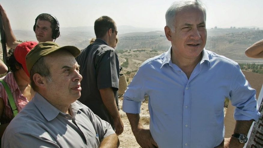 File - In this Aug. 31, 2005 file photo Benjamin Netanyahu, right, and parliament member and  Netanyahu's close ally Natan Sharansky speak to journalists during a visit to the West Bank settlement of Maaleh Adumim in the outskirts of Jerusalem. Polls this week suggest that the conservative Netanyahu, who has been prime minister for about a third of his nearly three decades in politics,  is likely to be returned for a fourth term when Israel will go to the polls on March 17, 2015. But new developments, especially the emergence of an array of unpredictable centrist parties, make things difficult to predict.  (AP Photo / Baz Ratner, File)