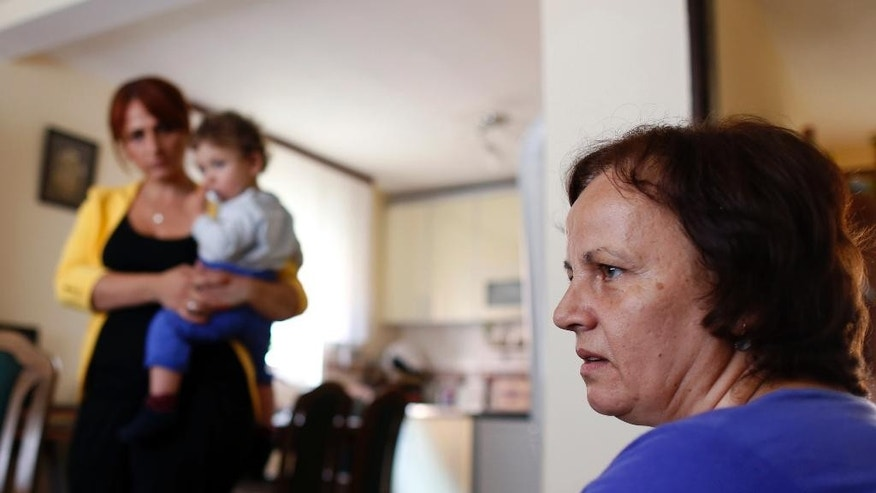 July 16, 2014 - FILE photo of Atifa Memovic, wife of Fikret Memovic, speaking to the AP in Prijepolje, Serbia. Memovic was a railway worker from southwest Serbia, who was traveling home from the capital, Belgrade, when his train unexpectedly stopped at a remote station in war-ravaged eastern Bosnia. A group of armed Bosnian Serb militia stormed in and abducted only non-Serbs after recognizing their Muslim names.