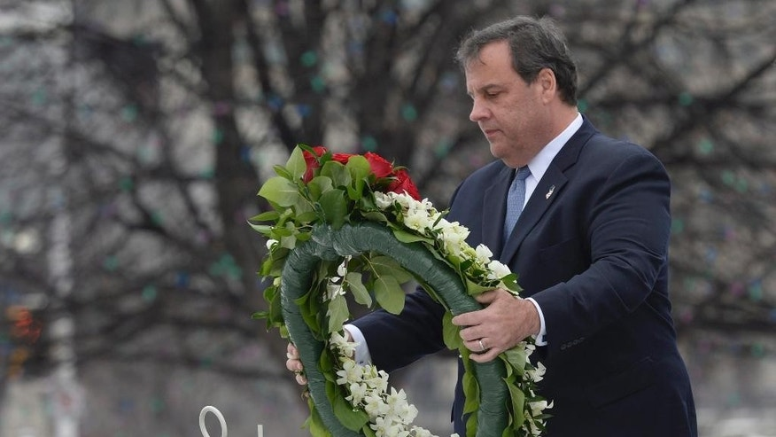 New Jersey Governor Chris Christie lays a wreath at the National War Memorial in Ottawa on Friday, Dec. 5, 2014.  (AP Photo/The Canadian Press, Adrian Wyld)