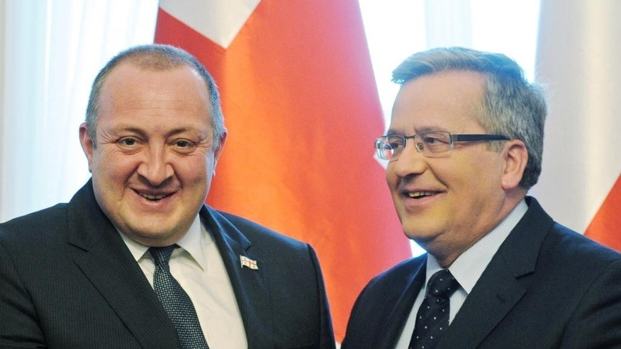 President of Georgia Giorgi Margvelashvili, left, is welcomed by his Polish counterpart Bronislaw Komorowski in front of the press in the Belweder Palace in Warsaw, Poland, Thursday, Dec. 4, 2014. Margvelashvili came to Poland for a working visit. (AP Photo/Alik Keplicz)