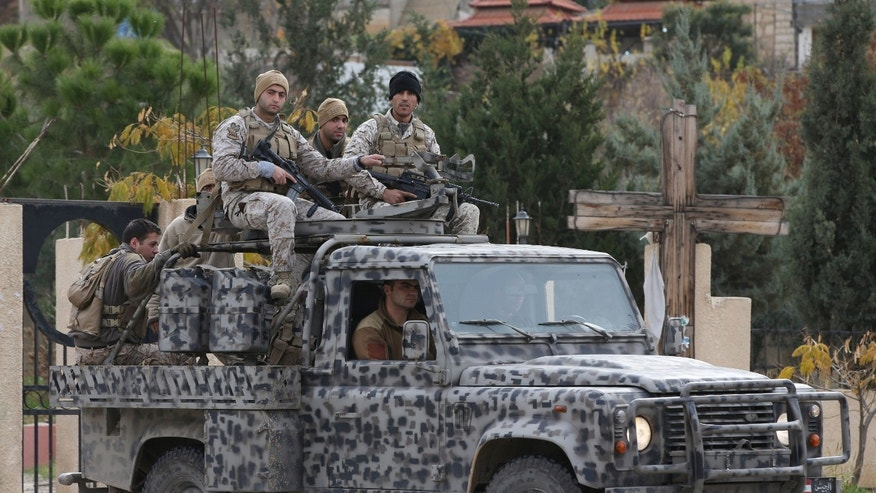 Dec. 3, 2014 - Lebanese army special forces patrol near the area militants ambushed Lebanese soldiers, in Ras Baalbek town, eastern Lebanon. Muslim militants pushed forward in their offensive on a major military air base in eastern Syria Friday capturing a nearby village in an attempt to take one of President Bashar Assad's last outposts in a province that borders Iraq, activists said.