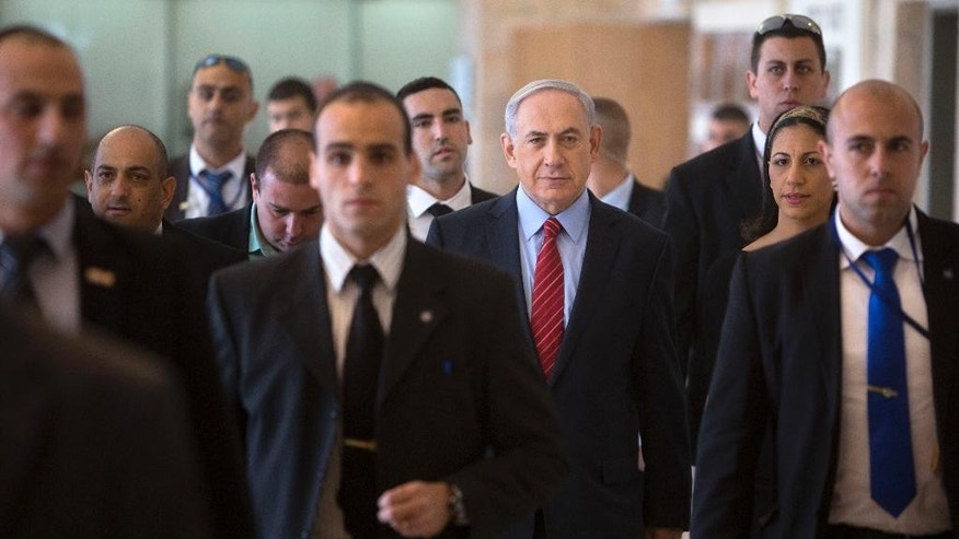 Israeli Prime Minister Benjamin Netanyahu, arrives to a faction meeting at the Knesset, Israel's parliament in Jerusalem, Wednesday, Dec. 3, 2014. Israeli lawmakers voted Wednesday to dissolve the Knesset, a preliminary step that will pave the way for early elections two years ahead of schedule. (AP Photo/Sebastian Scheiner)