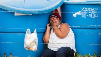 A relative of a inmate cries while waiting for information outside the David Viloria prison in Barquisimeto, Venezuela, Thursday, Nov. 27, 2014. At least 13 prisoners have died of drug overdoses and a further 145 are being treated for intoxication after inmates at an overcrowded prison facility in Venezuela stormed an infirmary during protests demanding better living conditions. (AP Photo/Dedwison Alvarez)