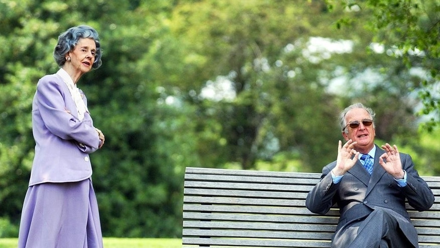 In this May 28, 2003 file photo, Belgian King Albert II gestures as he enjoys the beautiful weather with Queen Fabiola in the garden of the Royal Palace in Laeken, Belgium. Queen Fabiola, wife of former King Baudouin died at the age of 86 on Friday, Dec. 5, 2014. (AP Photo/Yves Logghe, file)