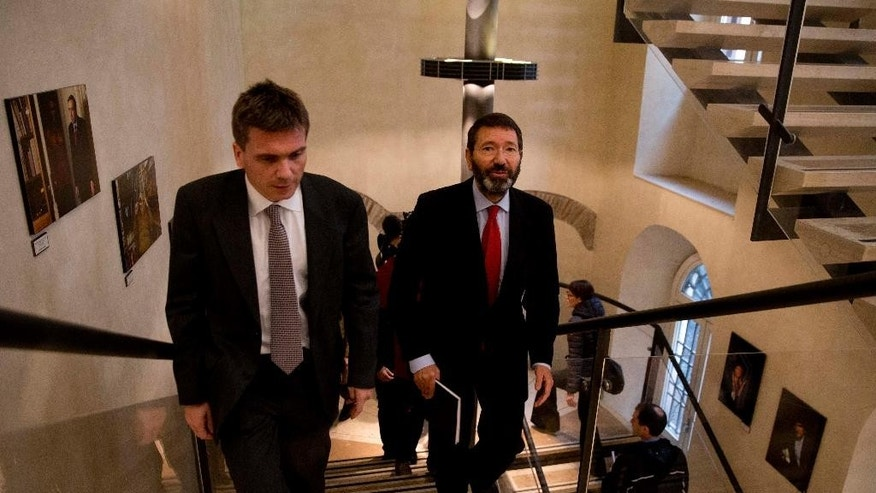 Rome's mayor Ignazio Marino, right, arrives to attend a press conference at the Foreign Press Club in Rome, Friday, Dec. 5, 2014. Marino told reporters Friday he'd decide soon on new security measures after local mobsters said in intercepted phone conversations he needed to be eliminated or chased out of office. They complained he was an obstacle to a well-oiled system of payoffs to win contracts for refugee centers and other municipal activities. (AP Photo/Alessandra Tarantino)