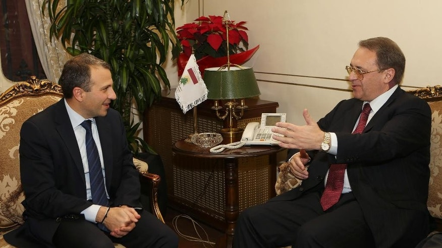 Lebanese Foreign Minister Gebran Bassil, left, meets with Russia's deputy Foreign Minister Mikhail Bogdanov, right, at the Lebanese foreign ministry, in Beirut, Lebanon, Friday, Dec. 4, 2014. Bogdanov is in Lebanon to meet with Lebanese officials. (AP Photo/Hussein Malla)
