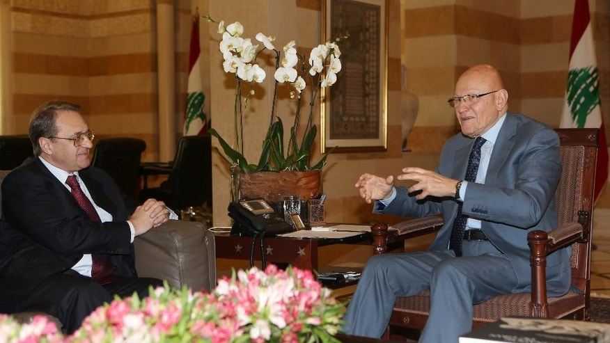 Lebanese Prime Minister Tamam Salam, right, meets with Russia's deputy Foreign Minister Mikhail Bogdanov, left, at the government palace, in Beirut, Lebanon, Friday, Dec. 4, 2014. Bogdanov is in Lebanon to meet with Lebanese officials. (AP Photo/Hussein Malla)