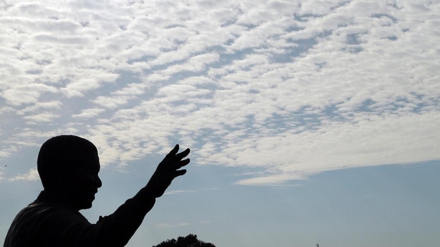 A nine-meter bronze statue of former South Africa President Nelson Mandela outside Union Buildings in Pretoria, South Africa, Friday, Dec. 5, 2014, on the first anniversary of former South African President Nelson Mandela's death. Events are to be held around the country for the former statesman who died last year at the age of 95.  (AP Photo/Themba Hadebe)