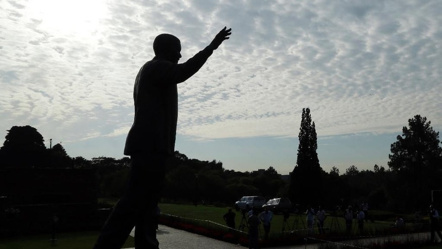 A nine-meter bronze statue of former South Africa President Nelson Mandela is placed outside Union Buildings in Pretoria, South Africa, Friday, Dec. 5, 2014, on the first anniversary of former South African President Nelson Mandela's death. Events are to be held around the country for the former statesman who died last year at the age of 95.  (AP Photo/Themba Hadebe)