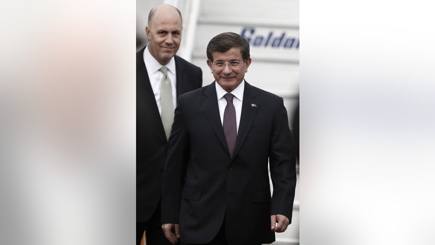 Turkish Prime Minister Ahmet Davutoglu arrives at the Athens' Eleftherios Venizelos airport on Friday, Dec. 5, 2014. Davutoglu is in Greece on a two day official visit and will meet with Greek Prime Minister Antonis Samaras on Friday. (AP Photo/Petros Giannakouris)