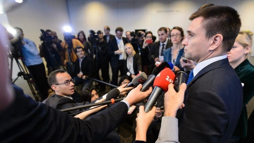 Ukrainian Foreign Minister Pavlo Klimkin speaks during a news conference  at  the  Organization for Security and Cooperation in Europe (OSCE) ministerial meeting at the Basel Exhibition Center, in Basel, Switzerland, Friday, Dec. 5, 2014.  (AP Photo/Keystone,Laurent Gillieron)